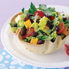 Taco Salad _ A honey-lime dressing distinguishes this Southwestern creation, which is served in edible bowls that are easily made from baked tortillas.