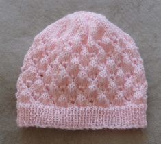 Baby's lace Beanie with rib band - knitting pattern - Molly This baby Beanie has a rib band, is worked in a lovely lace stitch then has a stocking stitch crown. To fit head: 35 cm ins]. Baby Cardigan Knitting Pattern Free, Knit Beanie Pattern, Knit Headband Pattern, Baby Hats Knitting, Crochet Baby Hats, Baby Knitting Patterns, Knitted Hats, Crown Pattern, Newborn Knit Hat