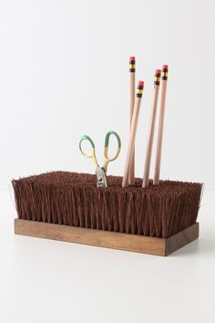 [Besom Holder] - Find a sturdy scrub brush with strong bristles and flip. Smart.