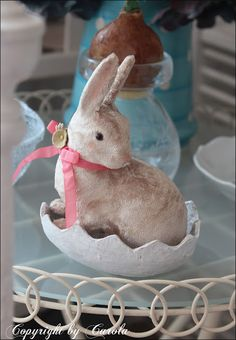 Sweet Easter bunny in white paper maché egg nest