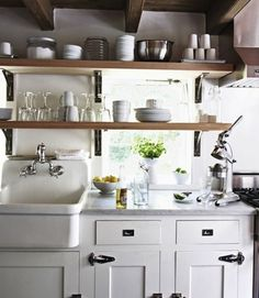 This tiny kitchen is a wonderful blend of modern, vintage, casual and stylish. It's a model for us all!