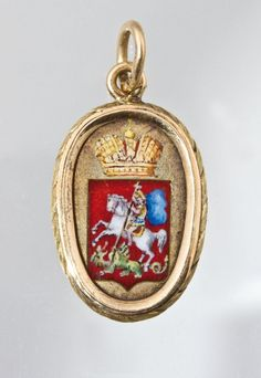 """Fabergé gold and enamel pendant of oval form. The front depicting St. George slaying the dragon in polychrome champlevé enamel. The reverse finely engraved with a cross and Cyrillic inscription """"ELENE B. KOCH MOSCOW 1909"""". Marked on suspension loop with 56 standard and master's mark """"AH"""". St. Petersburg, Fabergé, August Hollming, before 1909. 2.2 cm long, 5 gr."""