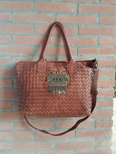 Hey, I found this really awesome Etsy listing at https://www.etsy.com/uk/listing/520687226/woven-leather-ethnic-bag-hand-tanned-in