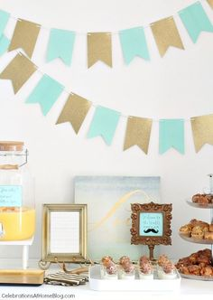 You'll love this aqua and gold sip and see baby shower that was hosted for new mom and baby boy. Pretty decor, brunch menu, and more!