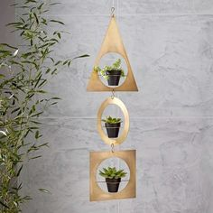 Showcase your favorite plants in cool geometric metal shapes. Just one makes a statement, but hung in multiples, these hanging pot holders become functional decor. Metal Hanging Planters, Hanging Succulents, Hanging Pots, Outdoor Planters, Diy Planters, Garden Planters, Indoor Garden, Planter Ideas, Stone Planters