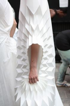 Yuki Hagino's designs are exquisite origami sculptures, with lots of interesting 3-dimentional details and shapes. Yuki was an Architecture graduate in Japan before coming to CSM to study fashion. We can see how she made use of her expertise in her designs to create these architectural and statuesque looks  #InfraRedAir #KarlKonrad #CharlesConrad