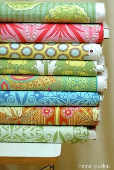 Pretty stacked fabrics... from German blogger Twins Garden.