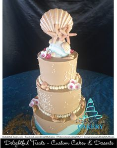 3 Tier Buttercream Beach Wedding Cake with Fondant Seashells Fondant Flowers Coral Bubbles Fondant Waves by Delightful Treats Cakery Orlando | #DelightfulTreats #Cakery #Orlando #OrlandoCakes #Buttercream #Beach #Wedding #Cake #Fondant #Seashells #Flowers #Coral #Bubbles #FondantWaves #BeachWedding #BeachWeddingCake #WeddingCake #FloridaWeddingCake #OrlandoWeddingCake #OrlandoCustomCakes #orlandoweddings #BeachWeddings #BeachWeddingTheme #CustomCakes #CustomWeddingCakes