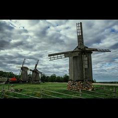 Wooden windmills on Saaremaa island in Estonia by Dmitri Korobtsov