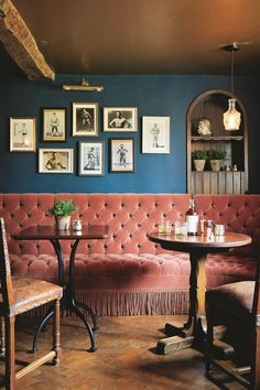 A vintage boxing-themed gallery wall, on the most beautiful dark-blue-painted wall at Artist Residence boutique hotel, Oxfordshire