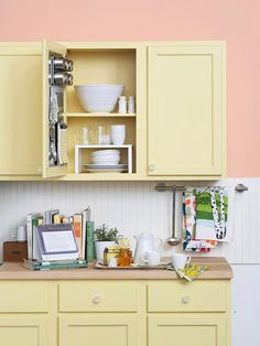Use freestanding stacking units to create levels of storage within your kitchen cabinets.