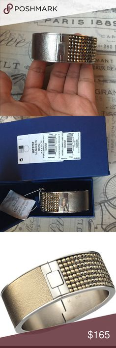 Swarovski authentic Intervalle bangle gold Worn 3-5 times, still in like new condition in original box and tags Swarovski Jewelry Bracelets