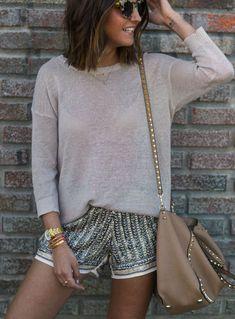 Beige sweater glossy shorts camel shoulder bag.