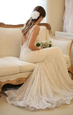 Low Cut Back Lace Wedding Dress. This is the type of dress I see myself in.