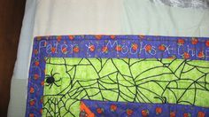 hand sewn names of all of her pets...border to Katie's Halloween quilt- sewn in glow in the dark thread!