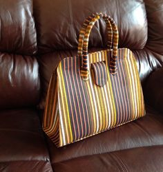 Striped African print handbag. Classy & chic just for you. Great @ $60! Will ship. Janeth_Okoronkwo@yahoo.com