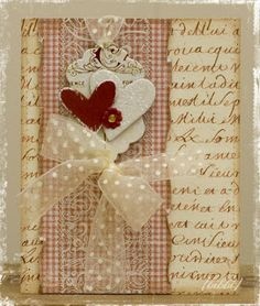 This beautiful card could be used for a handmade wedding or valentine's card. The text in the background can be made from a stamp, an old book, or a photocopy. Torn edges add to the feel of nostalgia, and the lace and sheer ribbon add romantic touches.