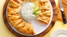 Buffalo Chicken Crescent Ring Recipe Appetizers, Main Dishes with cream cheese, hot sauce, cooked chicken, shredded Monterey Jack cheese, Pillsbury™ Refrigerated Crescent Dinner Rolls, crumbled blue cheese