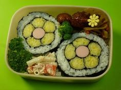 ▶ How to make a Bento (#14 Flower Sushi Bento) お花の寿司弁当 - YouTube. I love it! I like mixing the cooked egg yolks with rice to make it yellow.