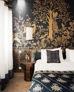 a mural of golden gazelles on black (which seems would also fit on this board) in this bedroom in the peacock pavilion in marrakech, designed by maryam montague (photo by patrick cline for lonny magazine, May '12) (HT apartment therapy)