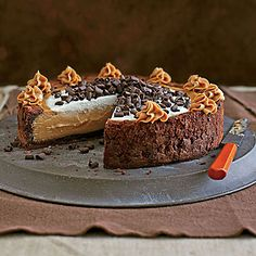 Cinderella Cheesecake | A chewy ring of brownie-batter crust folds over creamy and luscious peanut butter cheesecake. Yes, please!