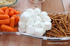 Snow man parts snack- carrots, marshmallows and pretzel sticks #dairyfree…
