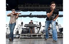 From left, David Pichette, Dale Wallace, and Brad Mates with Emerson Drive perform on the mainstage at the Big Valley Jamboree.