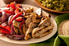 This chicken fajitas recipe stuffed full of grilled chicken, onions, and peppers is perfect for an easy and healthy weeknight dinner.