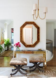 The vestibule of designer Shayelyn Woodberys Moroccan-inspired home features a console from Mitchell Gold + Bob Williams and stools by Baker.