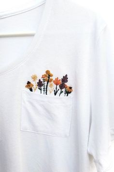 Dress up your favorite t-shirt with some DIY hand-embroidery. Perfect for beginners and advanced embroiderers alike, this digital embroidery pattern gives you all the instructions, tips, and tricks to embroider your very own t-shirt. Diy Embroidery Shirt, Embroidery On Clothes, Flower Embroidery Designs, Embroidered Clothes, Hand Embroidery Patterns, Applique Designs, Embroidery Fashion, Vintage Embroidery, Embroidery Stitches