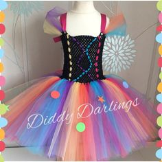 Clown Tutu Dress. Birthday Tutu Dress. Rainbow Tutu Dress. Beautiful & lovingly handmade.  All characters and colours available Price varies on size, starting from £25.  Please message us for more info.  Find us on Facebook www.facebook.com/DiddyDarlings1 or our website www.diddydarlings.co.uk