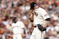 Ryan Vogelsong of the San Francisco Giants reacts in the first inning while taking on the St. Louis Cardinals during Game 4 of the National League baseball championship series at AT&T Park on Wednesday, Oct. 15, 2014. in San Francisco, Calif.  (Ezra Shaw/Getty Images)