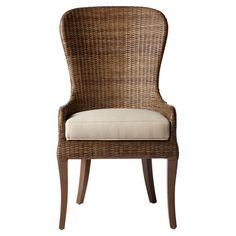 The subtle curves and high back of this rattan dining chair pair natural style with understated elegance.  Product: Chair