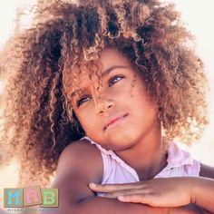 Mom: Caucasian Portuguese Dad: Angola African
