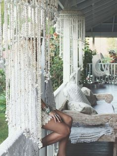 Shell chandeliers, daybed, hanging chair and timber verandah