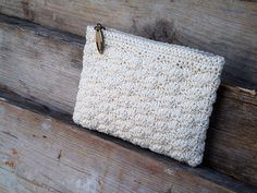 Cream crocheted pouch