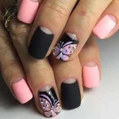 Are you a fan of contrasting colors on your nails? Then this design is perfect for you! The black and pink combination is simply amazing. The butterfly details are also enthralling with help of embellishments on top of it.
