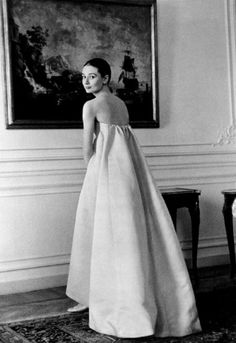"""In Rome, at a fitting for her new wardrobe designed by Hubert de Givenchy. She said of the designer that """"[he] gave me a look, a kind, a silhouette""""."""