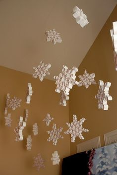 Qwilled Snow Flakes on a large scale, like 12 to 18 inches, strung from the ceiling, very cool idea!!!