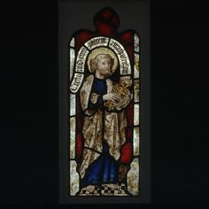 An English stained-glass panel, 1400-50, depicts Saint Peter with his symbolic attributes, the keys to heaven. (Victoria & Albert Museum)