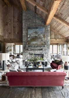 A rough-hewn timber ceiling crowns the living room of a lodge in Big Sky, Montana.