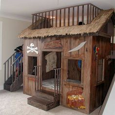 Stairs up one side, slide down the other, bed & bed, chalkboard wall, place to play house, building area, craft table.  Did I forget anything?