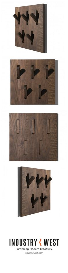 This walnut coat rack is both an exquisite design piece and a space-saving, storage solution. Designed by Patrik Turner for Ethnicraft, this piece is both aesthetically pleasing and practical. Flip out some or all of the Utilitiles hooks to hang coats, umbrellas or really anything.