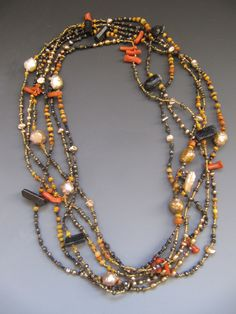 Two long strands wrapped 3 times...antique coral, antique Naga glass, pyrite, pearls, black tourmaline LuciaAntonelli.com