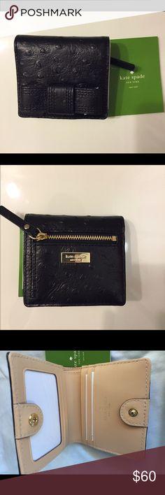 Kate Spade Black Bifold Wallet NWOT Kate Spade Bifold Wallet. ID, cash, card and coin pockets. Snap closure. Gold tone hardware details. kate spade Bags Wallets