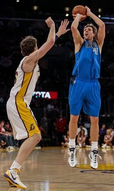 Dallas Mavericks forward Dirk Nowitzki shoots a three pointer over Los Angeles Lakers forward Pau Gasol during the first half of an NBA basketball game, Sunday, April 15, 2012, in Los Angeles. The Lakers won, 112-108, in overtime.