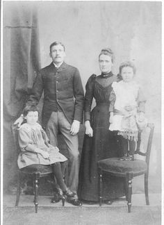 Cabinet print, c.1890-92. The morning coat with sloping fronts was fashionable for men in the late 19th century, often worn with narrow pin-striped trousers. Women's bodices and blouses began to show a puffed sleeve head c.1890. Girls might wear short fringed hair during the 1880s/early 90s. (Fiona Adams)