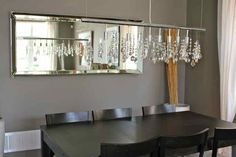 Beautifully decorated dining area using chandelier and mirror on the wall