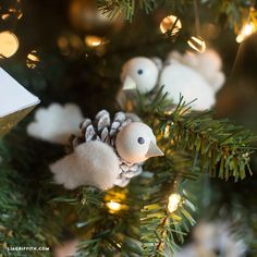 Make your own DIY bird ornaments using pinecones, felt and wooden balls. Perfect for hanging on the tree this Holiday season. By Lia Griffith