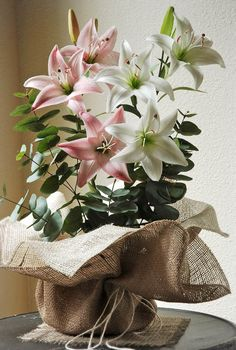 Burlap Pot Wrapping 24 x 24in Ivory/Natural.  From save-on-crafting web site on floral arrangements